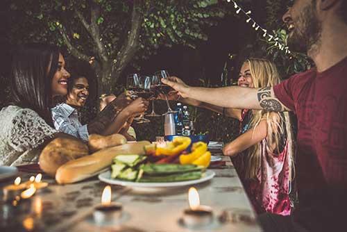 Friends enjoying an evening meal outside