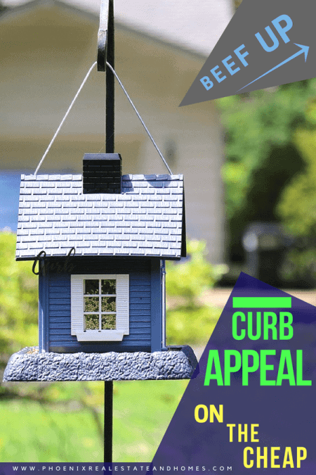 A bird house in the curb appeal of the house