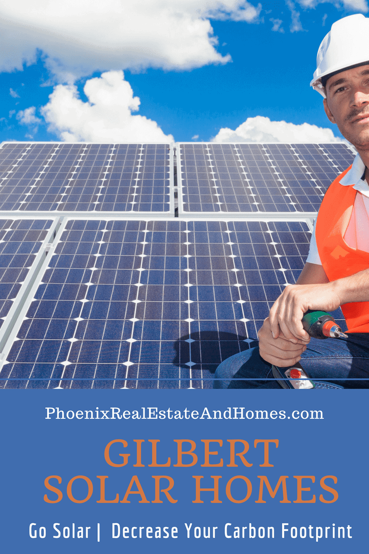 Solar panel expert on roof where installation is nearly complete of some Gilbert Solar Homes