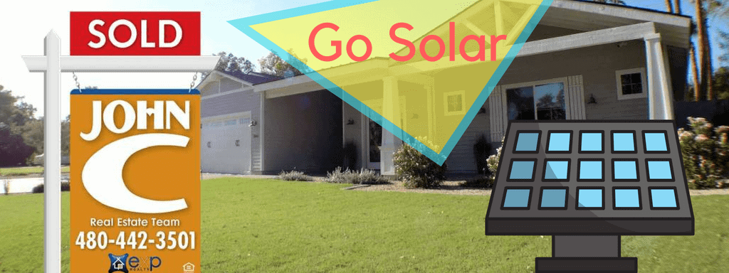 Single level Peoria Solar Homes with a SOLD by JOHN C sign and solar panel in the yard.