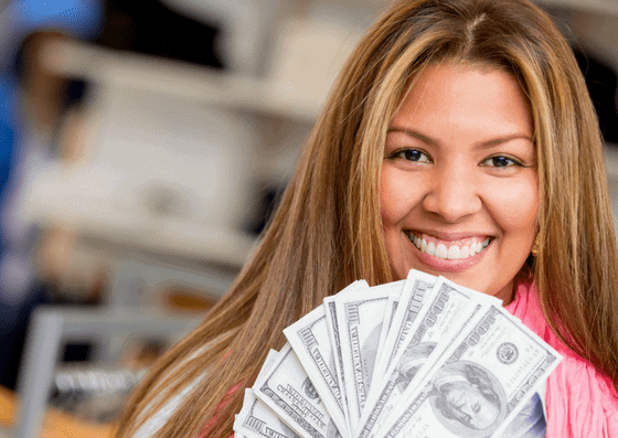 Young woman holding a lot of Cash and choosing than Getting Home Loan