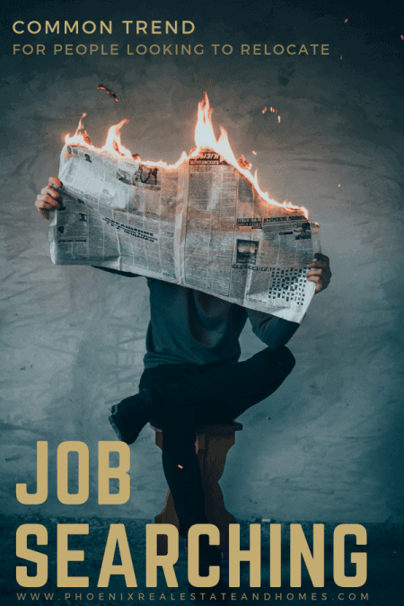 A man is having a job searching in a newspaper that is burning